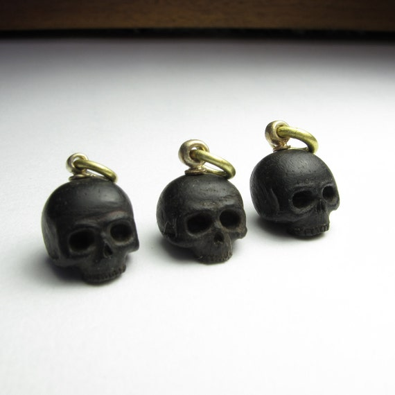 ebony skull listing for 1 on right only