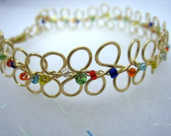 Infinity Wirewrapped Gold Cuff Bracelet with Multicolored Beads