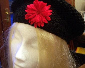 black beret with red felt flower