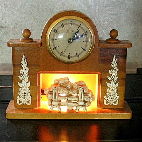 vintage FIREPLACE MANTLE CLOCK that lights up by United