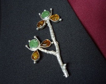 A little branch from my garden, cast in sterling silver is once more in bloom, this time with Jade and Amber Blossoms, Signed
