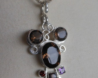 "Fun & lovely Curly brown Mouse has ""curly"" hair and a face and ears of Smoky Quartz and a collar with Garnet, Amethyst and Sapphire."
