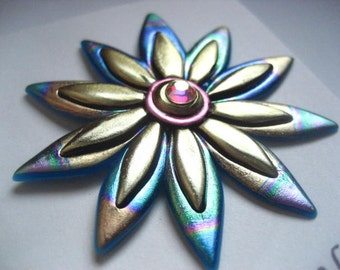 Flower pin in pink, gold, and green brooch