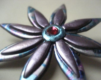 Flower pin in lavender and lavender, silver, and blue  patterned acrylic brooch