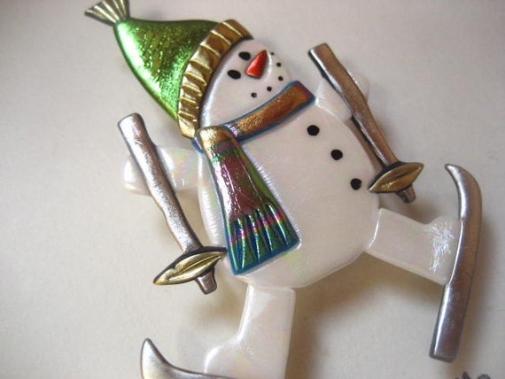 Skiing snowman with chartreuse hat pin brooch