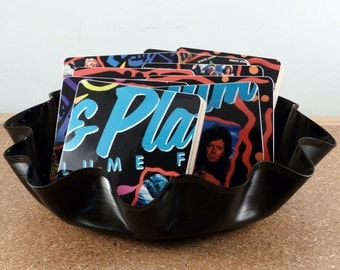 Rock Music coasters with wacky bowl from the GOLD and PLATINUM record album