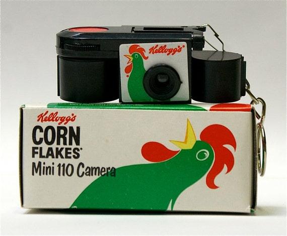 Vintage Keychain Kellogg's 110 film promotional camera and box.  SALE
