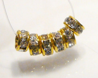 6 BEADS..Clear Crystal Gold Tone Rondelle Spacer BEADS....4mm...BB