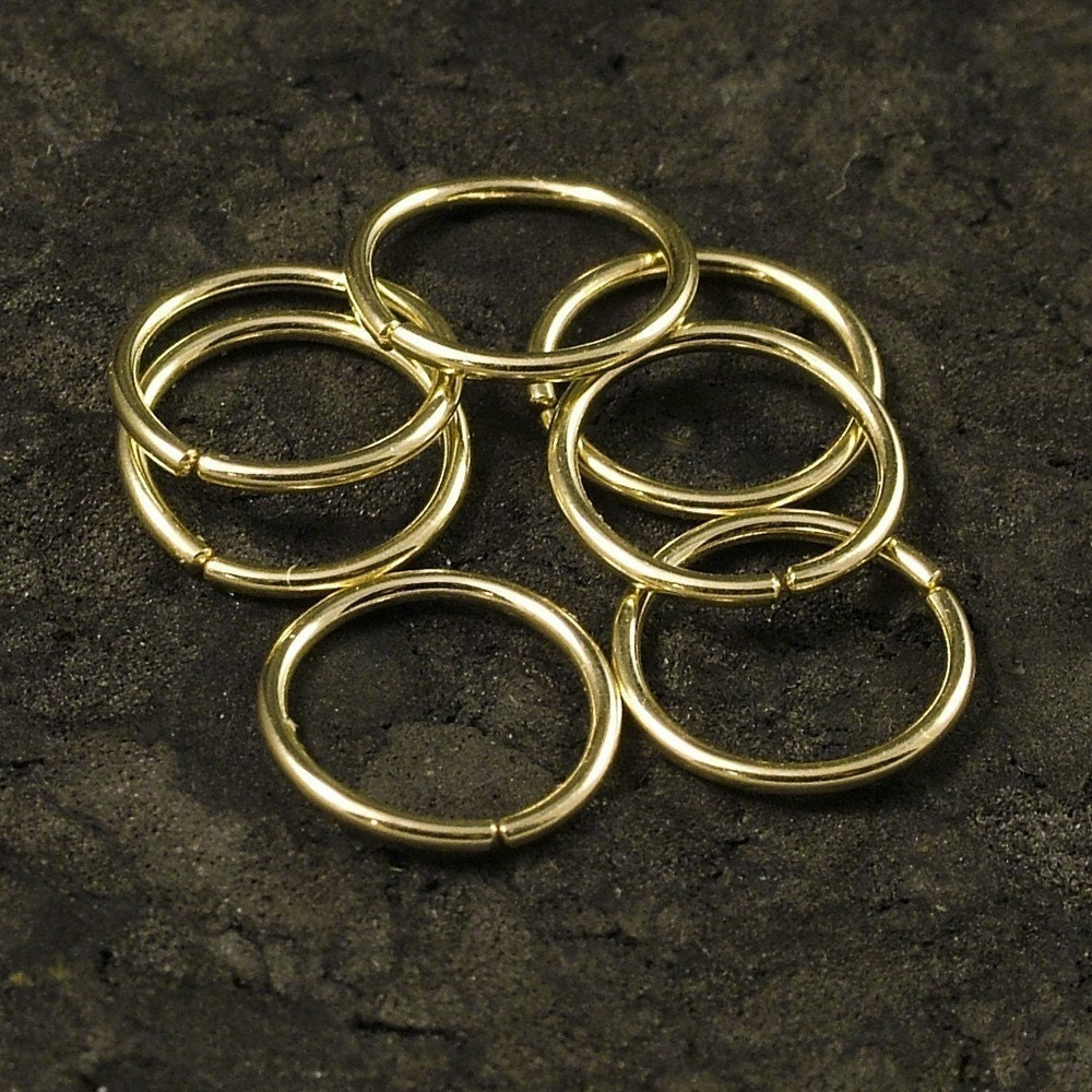 tiny gold hoop earrings catchless gold hoops endless gold
