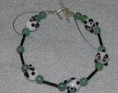 Adorable Bracelet with Ceramic Panda Bears Faces Accented with Black and Green Beads