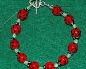 Ladybug, Ladybug Bracelet - Adorable Ceramic Ladybugs, Green Accents and Sterling Silver Toggle Clasp