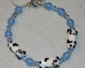 Beautiful Ceramic Panda Bead Bracelet Accented with Sparkling Swarovski Light Sapphire Blue Crystals, Light Blue Glass Beads and Bali Sterling Silver Toggle Clasp and Daisy Spacers