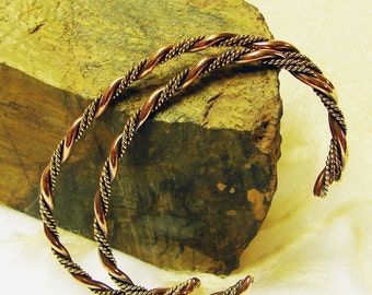 A Matching Pair of Handmade Copper and Brass Twisted Bangle Bracelets