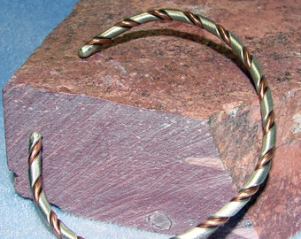 Sterling Silver and Copper Twisted Handmade Bangle