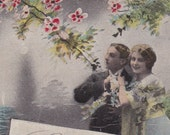 Antique French postcard with romantic couple.