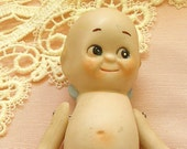 Antique Kewpie doll, Large bisque googly eye style.