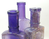 Purple pharmacy bottles, 3 amethyst apothecary glass.