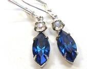 50s Rhinestone earrings, Sapphire blue stones on silver.