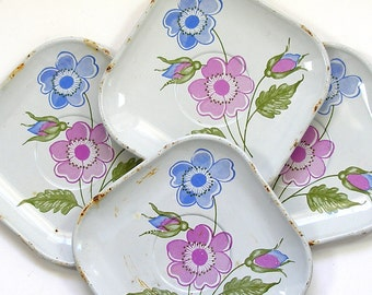 50s Tin Toy tea plates, 4 matching blue & purple flowers.