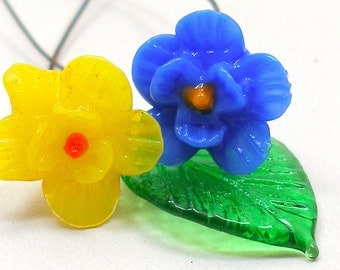 Tiny art glass flowers, 1930s Czech yellow & blue with leaf on wire stems.