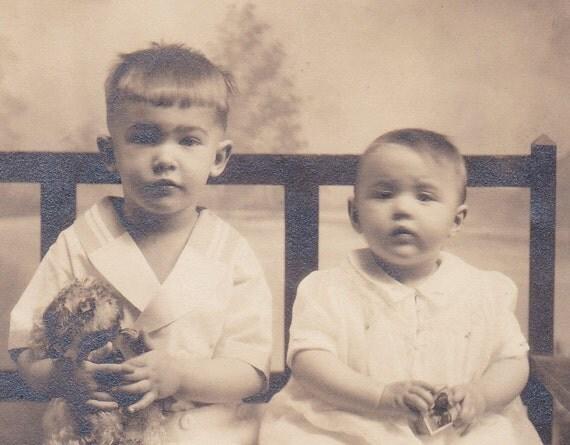 1910s Portrait of 2 children & a toy, photograph, paper ephemera.