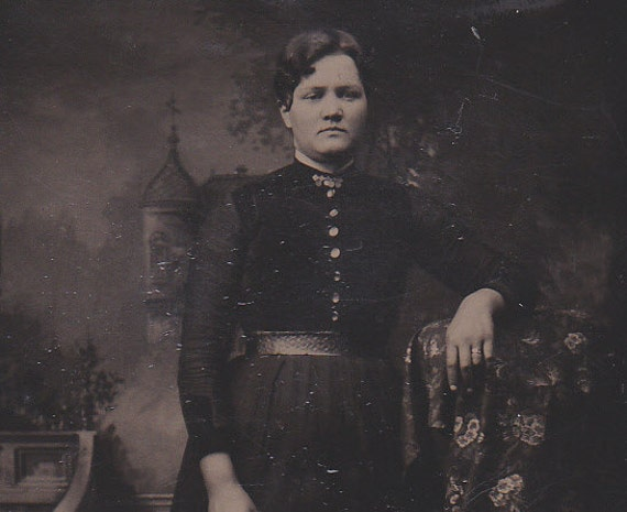Antique tintype portrait of a lady, ferrotype photograph.