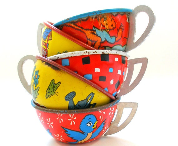 50s Tin Toy Tea cups, 5 in red, yellow, blue with monkey and bird graphics, Instant Collection.
