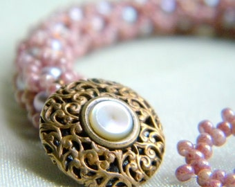 Mauve and Pearl Hand beaded Bracelet