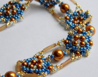 Hand beaded Blue, Copper and Gold Bracelet