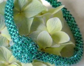 Aqua and Green hand beaded Bracelet with magnetic clasp