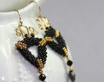 Black and Gold Hand beaded earrings with 14k gold filled findings and Faceted Spinel