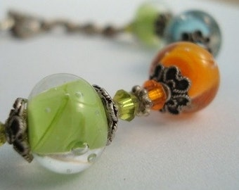 Brightly Colored Hand made Lampwork beaded Bracelet with sterling silver findings