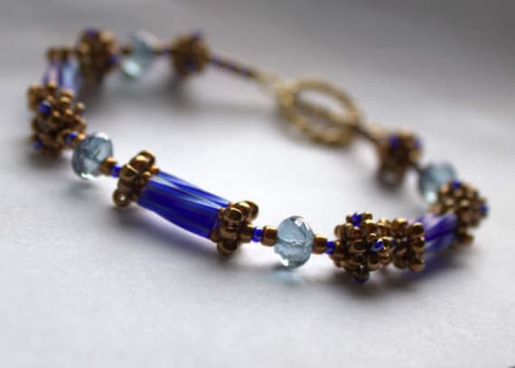 Hand Beaded Bracelet with Blue quartz Rondelles and 9 Hand beaded beads, with 14k gold filled toggle
