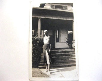 Vintage Sexy Dressed Black Woman Posing in Front of A House Photo
