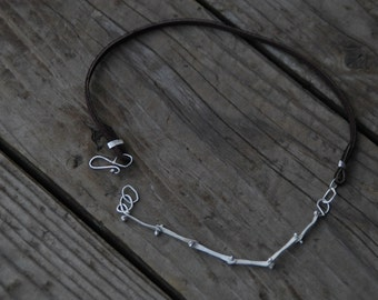 delicate but rugged sterling silver chain necklace