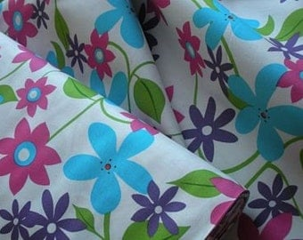 Bright Flowers on White Fabric by Robert Kaufmann