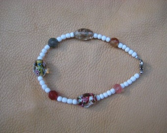 Mixed bead glass art bracelet with floral theme and spring colors