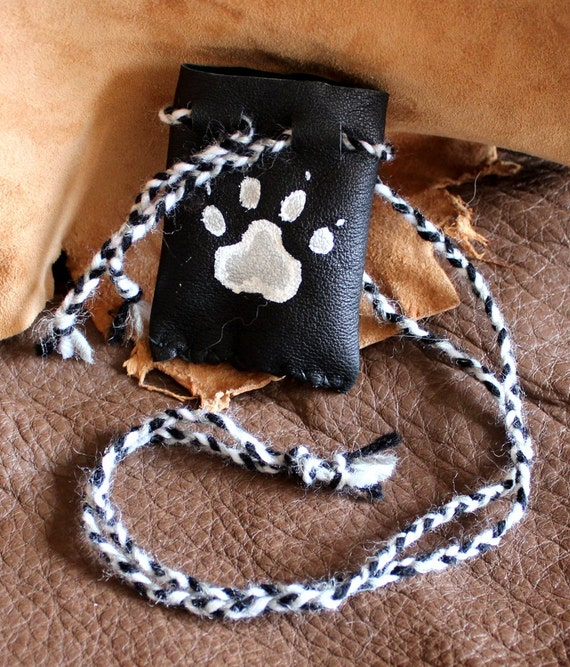Black leather necklace pouch with white and silver painted wolf paw print for crystals, herbs, medicine and other small sacred things