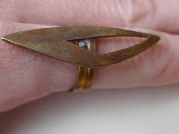 Vintage brass adjustable ring base. Unusual shape.