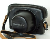 Konica Auto S 1960s camera with original leather carrying case and strap