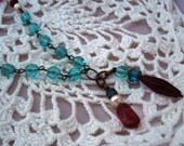 Aqua and red crystal necklace with pearl accents