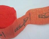 orange KEWPIE DOLL hand stamped crepe paper banner (373 inches, 10.33 yards)