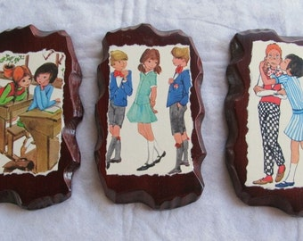 BIZARRE LOVE TRIANGLE set of 3 wooden wall hangings
