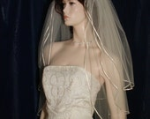 wedding bridal veil  3 Tier Fingertip length Graceful and Traditional finished with a tiny Satin Ribbon Trim