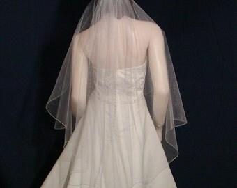 Shimmering  Angel Cut fingertip length bridal veil with an  Iridescent pencil edge