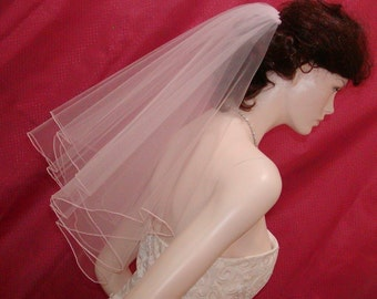 two tier Elbow length Circular Cut Bridal Veil  finished with a delicate Pencil Edge