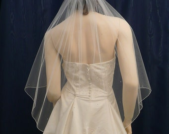Swarovski Rhinestones add a wonderful glitter to this Elbow length Angel Cut Bridal Veil