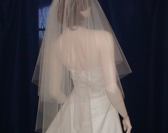 A Softly flowing Circle of Tulle makes up this 2 tier Fingertip Length Bridal Veil