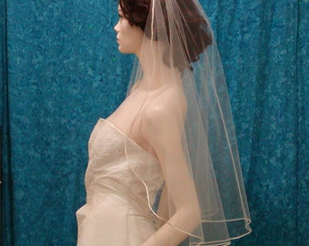 Cascading Cut Bridal veil trimmed with a Satin Rattail Cord