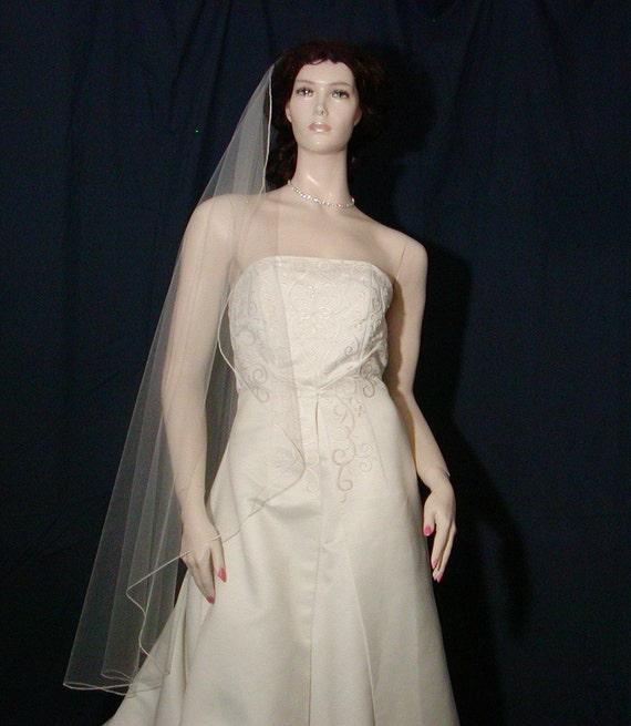 Softly flowing  Waltz length bridal veil